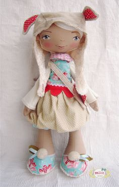 Soft fabric doll in red and blue with rabbit ears. $150.00, via Etsy.