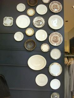 Mis-matched plates in the windows of Club Monaco on Fifth Avenue in NYC.