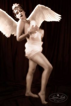 2015 - Vintage Cupid By: Laura Locks Beauty Concept: Laura Miranda - Laura Locks Beauty Hair/Special Effects Makeup/Wardrobe: Laura Miranda - Laura Locks Beauty Photographer/Image Editor/Prop Fabricator: Robert Daniel Production Assistant: Alyx Munoz Model: Maxine Lynette
