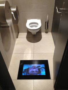 Movie theaters with screens in the bathroom so you don't miss anything.