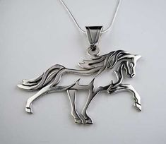 Sterling Silver Sun Dancing Horse Necklace. A dynamic design full of movement and energy. Help me with this horse do you think he is gaited? A Standardbred? Maybe a Morgan? He sure is powerful and rea