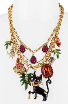 197a4329360a Necklace BETSEY JOHNSON Necklace A fashionable feline prances along gold  chains hosting a jungle of fanciful