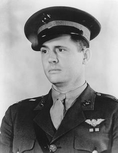 "Henry Talmage ""Hammerin' Hank"" Elrod  was a US Marine Corps aviator. He was the first aviator to receive the Medal of Honor during World War II, for his heroism in the defense of Wake Island. When all the U.S. aircraft had been destroyed by hostile fire, he organized remaining troops into a beach defense unit which repulsed repeated Japanese attacks. On December 23, 1941, Captain Elrod was mortally wounded while protecting his men who were carrying ammunition to a gun emplacement."