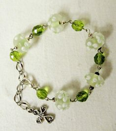 Cross charm bracelet with lampwork glass and by Gwendysgems