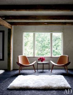 Hans J. Wegner chairs from Suite New York flank a table from Design House Stockholm in the master bedroom.