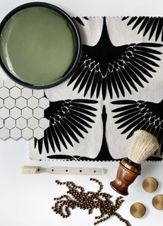 Love the dark green, black and white penny tile, wood and brass hardware
