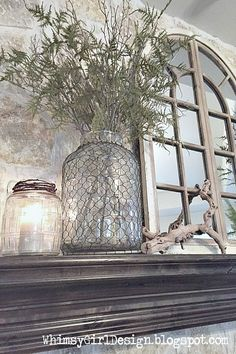 mirror & glass on mantle Using items that can be switched up easily is a budget friendly way to decorate. This large jar from Homegoods is easy to change up with seasonal stems for a fresh look every few months! Country Decor, Rustic Decor, Farmhouse Style, Farmhouse Decor, Farmhouse Fireplace, Vibeke Design, Family Room, House Design, Home Decor
