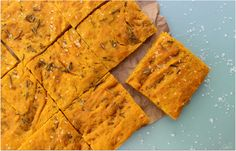 This savory focaccia bread is fall inspired using fresh pumpkin and rosemary. Easy to make, yet looks and tastes gourmet. -- 1 1/3 cup cooked pumpkin, mashed or canned pumpkin 1 ¾ teaspoons instant yeast 3 ¾ cups unbleached all-purpose flour 1 cup water (warm, 105 to 115 degrees) 2 tablespoons olive oil, plus more to grease bowl/pan 1 ¼ teaspoons salt Topping: 2 tablespoons extra-virgin olive oil 2 tablespoons fresh or dried rosemary (I prefer fresh) 3/4 teaspoon sea salt, coarse