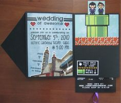 interactive design that shows the bride and groom to be coming out of a Mario-style pipe and a game over screen with the wedding info when someone pulls on the ribbon in the card