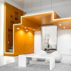A young couple requested their bed be lofted directly above the door of their new bedroom. Batlab's solution? Incorporate a homogenous ribbon of zigzagged MDF on a steel-supported structure that acts simultaneously as floor, ceiling, stairs, and bed. The red-orange loft structure adds vibrance to the otherwise monochromatic bedroom. : Norbert Juhász. #architecture #interiors #design #interiordesign #bedroom #loft