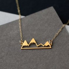New Dainty Mountain Necklace - Gold Beautiful gold mountain range charm on a dainty gold chain. Clasp closure. Jewelry Necklaces