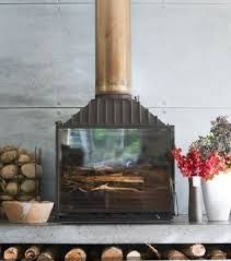 Cheminees Phillippe fire place with copper flue Fireplace Tv Wall, Stove Fireplace, Modern Fireplace, Fireplace Surrounds, Fireplace Design, Fireplace Ideas, Metal Garden Gates, Indoor Outdoor Fireplaces, Freestanding Fireplace