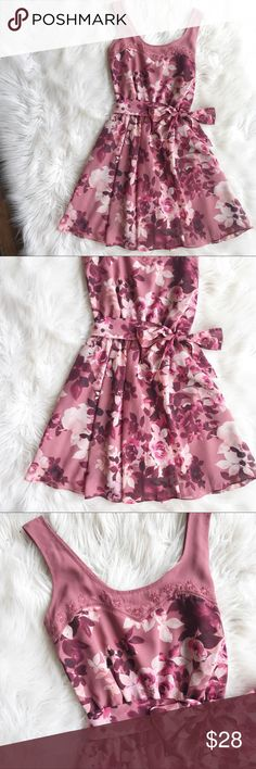 LC Lauren Conrad Floral Dress Excellent condition Floral fit & flare dress by LC Lauren Conrad. Tie sash around waist, fully lined. Very chic and feminine. Embroidered floral design at neckline. Size 2. No trades, offers welcome. Bundle for additional discounts. LC Lauren Conrad Dresses