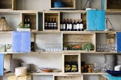 Storage shelfs made of reclaimed scaffolding wood for the restaurant Gallito en Barcelona by usame.es