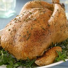Butter Herb Roast Chicken - A traditional roast chicken with our PERDUE® HARVESTLAND® Whole Broiler, combining fresh herbs and spices. Serve whole chicken with more herb garnish for a farm fresh look. Whole Baked Chicken, Herb Roasted Chicken, Fresh Chicken, Stuffed Whole Chicken, Roast Chicken, Oven Chicken Recipes, Meat Recipes, Real Food Recipes, Cooking Recipes
