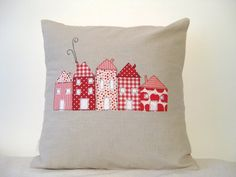 Cushion cover, red houses in a row. mom you could make these sort of things! so cute. just make the pillow covers
