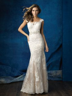 On this lace sheath, a bateau illusion neckline gives way to a dramatic back // Allure Bridals 9371