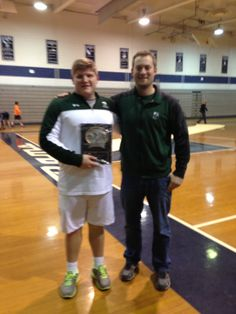 Senior Tommy Rhodes '14 broke Steve Bienko 94's 20 year record in the Indoor Shot Put on January 27, 2014 at the Randolph Invitational. Here is Rhodes on left with Green Wave Throwing Coach Sean Rose