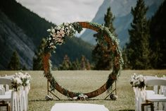 This gorgeous Tunnel Mountain Wedding ceremony in Banff was framed perfectly by this circle arch way covered in greenery and blush roses with unreal mountain views in the background. Wedding Arch Flowers, Wedding Ceremony Decorations, Wedding Flower Arrangements, Floral Wedding, Wedding People, Outdoor Wedding Inspiration, Lodge Wedding, Amazing Weddings, Wedding Signage