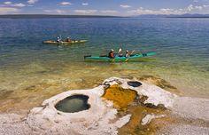 Kayakers at West Thumb Geyser Basin on Yellowstone Lake, Wyo. (© Rob Crandall/Alamy)