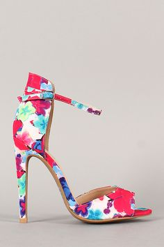 Color your world with this gorgeous open toe heel. Featuring beautiful floral print fabric upper, single band at front vamp, stitching accents, and stiletto heel. Finished with padded insole and adjustable ankle strap with buckle closure.