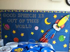 Good Speech Is Out Of This World bulletin board. Don't mind the drums of cleaning supplies in front :)