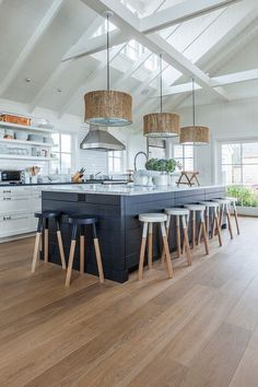 Kitchen flooring is Russian White Oak, Fumed, Prime Grade, Hardwax Oil White Tint. The planks are 8″ wide.
