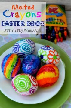 Melted Crayon Easter Eggs, when the eggs are still hot draw on them with a crayon the BOLD BRIGHT COLORS pop and make the most beautiful egg...