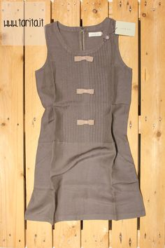 Tarita S/S 2013. Indi & Cold, 100% linen dress with bows.