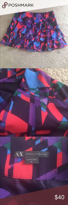 A/X Armani Exchange Skirt NWOT - Multicolored A/X Armani Exchange Pleated Mini Skirt. It has a side zipper, slit underneath, and a size 6. Colors are: Light Blue, Purple, Red, Plum, and Green. A/X Armani Exchange Skirts Mini