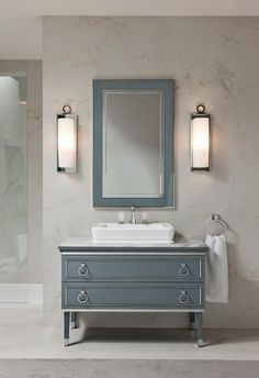 Fun cabinet & color. Maybe for guest bath or powder room | Lutetia luxury bathroom collection with Deco design inspiration in vanities cabinets and tall units decorative appliques and accessories luxury make-up console unit