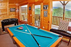 A View is Forever -- In the downstairs den area you can enjoy a game of pool or foosball or step out on the back deck to take a dip in the hot tub.