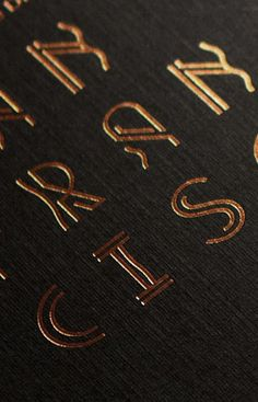 Embossed foil. Decorative type.
