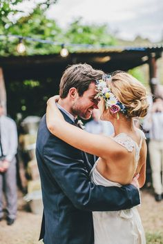 I love the flowers in her hair and the lace details in her dress!