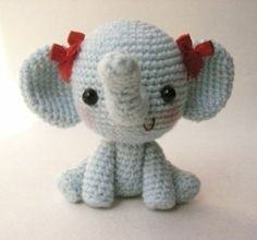cute little elephant toy girl red ribbons sitting down