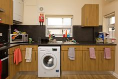 Forest Grove shared house: here's a typical kitchen, which includes a washing machine, fridge freezer and microwave. Forest Grove, Freezer, Washing Machine, Microwave, Home Appliances, Student, Kitchen, House, House Appliances