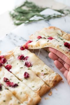 Quick and easy, creamy and crispy. Quick + Creamy Cranberry Brie Flatbread is a holiday appetizer everyone will love that takes minutes to throw together.