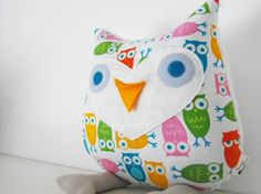 "This soft owl toy is ready to leave the nest and fly off to a new loving home. He would make the most adoreable addition to any home and is sure to bring a smile to your face, ( no matter if you're young or old!)    This cuddly lil' cutie is about 10"" X 10"" with 4"" legs and is stuffed plump with environmentally conscious EcoFill,(made from recycled plastic bottles.) His sweet face is a mix of wool felt and Eco Felt."