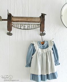 """Antique Clothes Wringer and a Vintage Baby Dress as Laundry Room """"wall art"""" ~~~via Knick of Time Farmhouse Sheds, Vintage Farmhouse, Farmhouse Decor, Farmhouse Style, Farmhouse Lighting, Laundry Room Bathroom, Laundry Room Remodel, Laundry Rooms, Laundry Decor"""