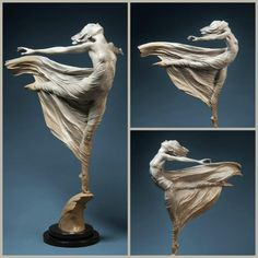 "Ascending by Artist Karl Jensen. 19"" Cast Bronze, edition of 50. At the Quent Cordair Fine Art Gallery."