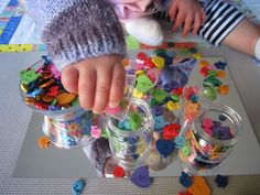 Reggio activities for toddlers using mirrors and buttons. having the Tes and Karoom organize by color right now :-)