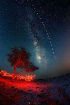 ISS parallels The Milky Way. In the desert of Qatar.