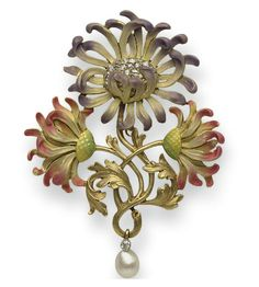 AN ART NOUVEAU DIAMOND AND ENAMEL CHRYSANTHEMUM BROOCH, BY PLISSON & HARTZ Centering upon a lavendar and cream enamel chrysanthemum with an old mine-cut diamond cluster pistil, bordered by two pink, cream and green enamel chrysanthemums, joined by textured gold stems and leaves, suspending a pearl and diamond drop, mounted in 18k gold, circa 1895, with French assay mark, (with pendant hoop for suspension and detachable brooch stem)
