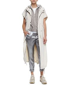Short-Sleeve Hooded Taffeta Maxi Coat, Hooded Perforated Mink Fur Vest, Short-Sleeve Stretch Cotton T-Shirt & Silk Lamé Roll-Cuffed Pants by Brunello Cucinelli at Bergdorf Goodman.