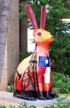 """Oil Patch jack rabbit in Odessa, Texas. As an Art Project, local artist painted these jackrabits in many different motifs. They then positioned them in different """"hot spots"""" around town for photo opps and general enjoyment. Odessa Texas, Midland Texas, Texas Roadtrip, Texas Travel, Jack Rabbit, Bunny Rabbit, Only In Texas, Loving Texas, Texas Flags"""
