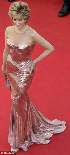 Timeless elegance: Jane Fonda may be 74, but she looks decades younger in her shimmering Atelier Versace bronze gown, which shows off her tiny waiste