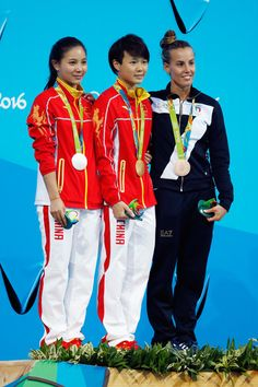 (L-R) Silver medalist Zi He of China, gold medalist Tingmao Shi of China and bronze medalist Tania Cagnotto of Italy pose on the podium during the medal ceremony for the Women's Diving 3m Springboard Final on Day 9 of the Rio 2016 Olympic Games at Maria Lenk Aquatics Centre on August 14, 2016 in Rio de Janeiro, Brazil.