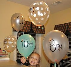 NYE Balloon countdown. Each hour pop a balloon and do whatever the paper says.....bake cookies, look at photos of the year about to end, etc!