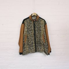 Size┊medium  Label┊east west silks  Condition┊10/10 Amazing silk zip jacket in a tawny gold snakeskin print with black and copper contrast panels. Super lightweight with a slant picket on each hip and elasticized cuffs. Lined. ✂  All measurements taken lying flat.  22.5┊shoulders 23┊sleeves 26┊chest 25┊hips 31┊height including collar  ° ° ° Additional items ship for free in North America!  As with all merchandise, the jacket gets cleaned, steamed, and wrapped lovingly before it is mailed...