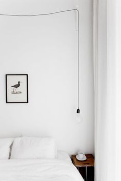 Wonderfully Simple Light Fixture in a minimalist bedroom | Anna Gillar.